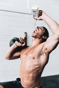 man drinking water and working out